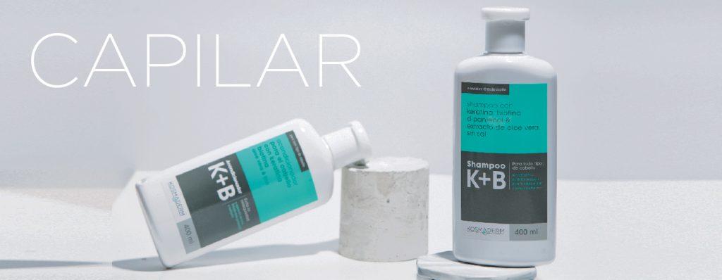 Logo Capilar fondo gris con dos recipientes de Shampoo K+B